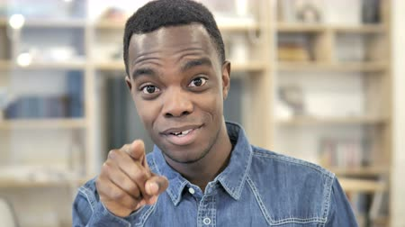 invite : African Man Pointing toward Camera with Finger Stock Footage