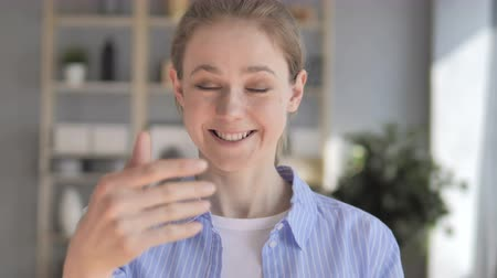 invite : Inviting Gesture by Young Woman at Work