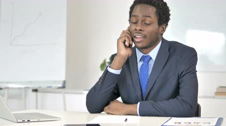 discar : Negotiating African Businessman Talking on Phone