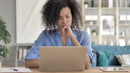 weboldal : Pensive African Woman Working on Laptop