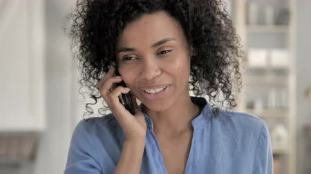 discar : Phone Talk by African Woman Stock Footage