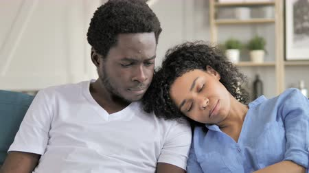 megvitatása : Pensive African Man with Sleeping Girlfriend on Shoulder