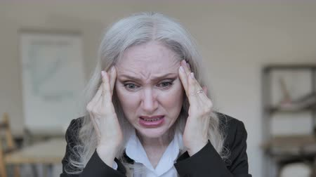 disappointment : Senior Businesswoman with Headache