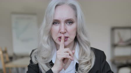 тайна : Silent, Silence Gesture by Mature Business Woman