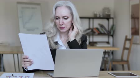 documentation : Old Business Woman Reading Documents Stock Footage