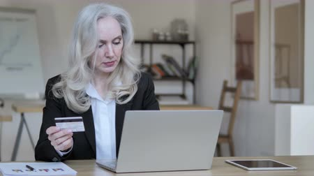 cash free : Online Shopping by Senior Businesswoman