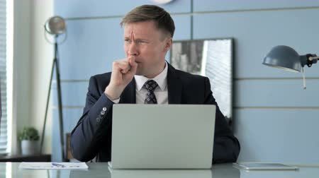infectious : Sick Businessman Coughing at Work Stock Footage