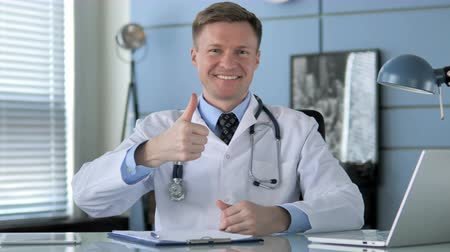 emin : Thumbs Up by Confident Doctor in Clinic