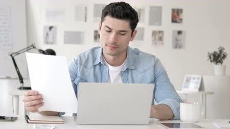 подпись : Casual Young Man Working in Office on Paperwork