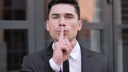 privacy : Finger on Lips, Senior Aged Businessman Gesturing Silence