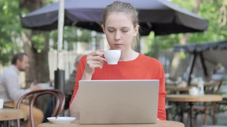 americano : Woman Sitting on a Cafe Terrace Stock Footage