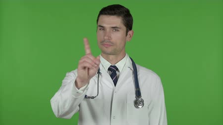 medical student : Young Doctor saying No with Finger, Chroma Key