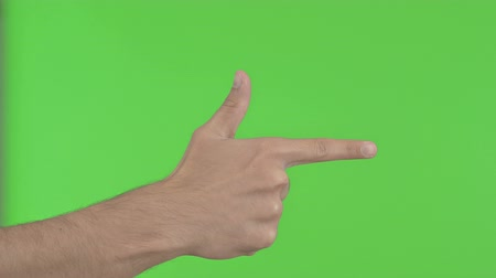příležitost : Pointing with Finger on Green Background