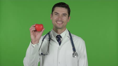 medical student : Handsome Doctor showing Heart Symbol, Chroma Key Stock Footage