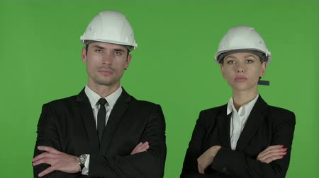armen over elkaar : Serious Male and Female Business Professionals Standing with Arms Crossed, Chroma Key