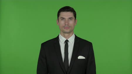 introspection : Young Businessman looking at Camera, Chroma Key Stock Footage