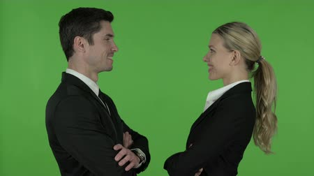 beckoning : Attractive Male and Female Professional Looking at each other and Smiling, Chroma Key