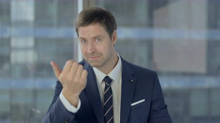 beckoning : Ambitious Businessman Pointing with Finger and Inviting