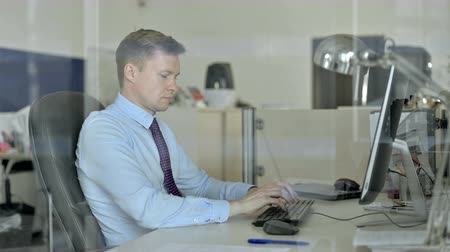 meia idade : Young Handsome Businessman Working on Office Computer