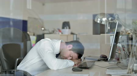 adversidade : Sleepy Middle Aged Businessman having Nap while Working in his Office