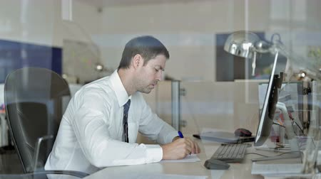 meia idade : Ambitious Middle Aged Businessman Writing Business documents on Office Table