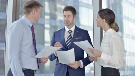 sharing : Executive Business people sharing Project through Documents in Boardroom Stock Footage