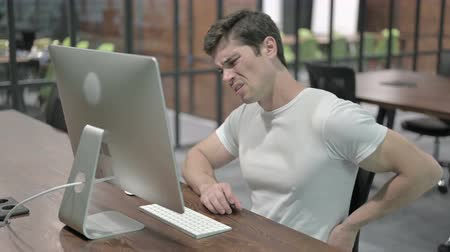 ortopedia : Back Pain, Uncomfortable Young Man Working on Computer