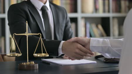 libra : Close up Shoot of Lawyer Hand Shaking with other Person on Table