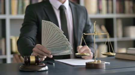 libra : Close up Shoot of Lawyer Hand holding Money in Court Room Stock Footage