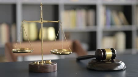 libra : Gavel and Gold Brass Balance Scale on Lawyer Office Table