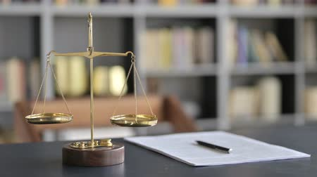 gabela : Gold Brass Balance Scale with Document on Lawyer Table