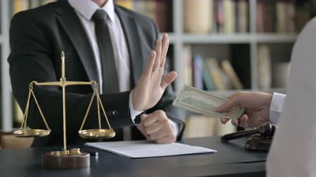 terazi burcu : Close up Shoot of Lawyer Hand Sign to Refuse taking Money Stok Video
