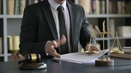 libra : Close up Shoot of Upset Lawyer Hand Checking Document in Court Room