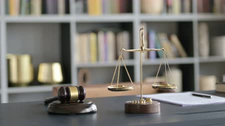 libra : Close Up of Balance Scale and Gravel on Court Room Table Stock Footage
