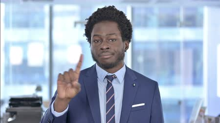 etnia africano : African American Businessman saying No with Finger Sign