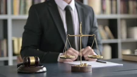 libra : Close Up of Balance Scale and Gravel on Table with Lawyer