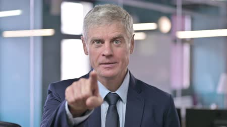merging : Portrait of Middle Aged Businessman Pointing Finger on Camera Stock Footage
