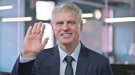 merging : Portrait of Middle Aged Businessman Waving and Smiling Stock Footage