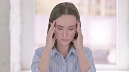 hardworking : Portrait of Hardworking Young Woman having Headache Stock Footage