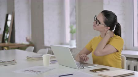 ortopedia : Tired Young Female Designer having Neck Pain in Modern Office Wideo