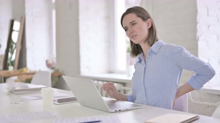ortopedia : Tired Young Woman having Back Pain in Modern Office Wideo