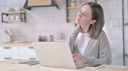 ortopedia : Tired Young Woman having Neck Pain in Office