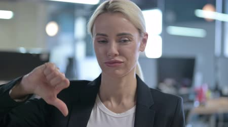 pouze ženy : Portrait of Disappointed Businesswoman Showing Thumbs Down