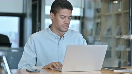 escritórios : Young African Man Leaving working Desk at Work Stock Footage
