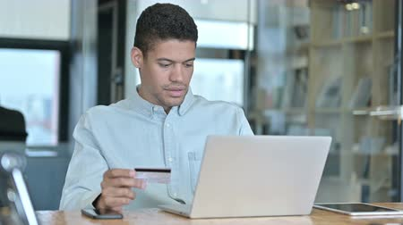 ホワイトカラー : Successful Online Shopping, Young African Man using Credit Card