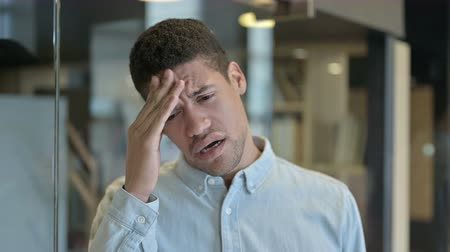 disappointment : Tired Young African Man having Headache in Modern Office Stock Footage