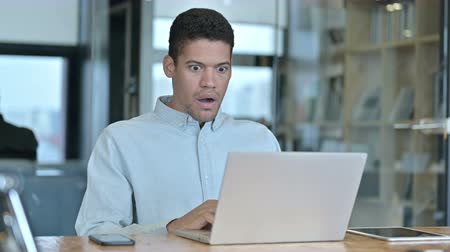porażka : Young African Man getting Shock on Laptop at Work Wideo