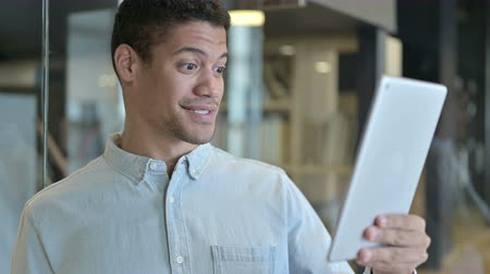 negotiate : Young African Man doing Video Chat on Tablet Stock Footage