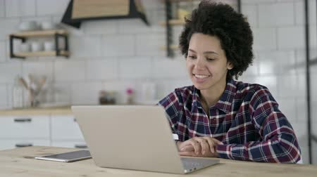 meeting negotiate : African American Woman doing Video Chat on Laptop