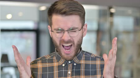 one man only : Portrait of Young Designer Screaming in Modern Office Stock Footage